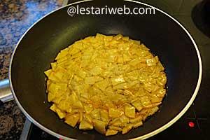 deep-fry the sliced potatoes