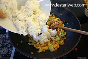 add the cold cooked rice