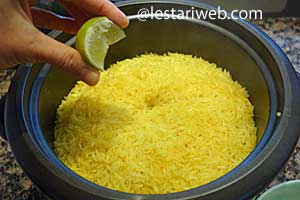Squeeze lime onto the rice