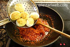 adding fried eggs