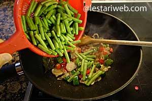 adding green beans