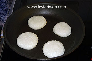 frying coconut pancakes
