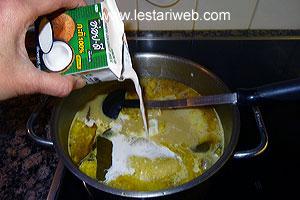 adding coconut milk to spices